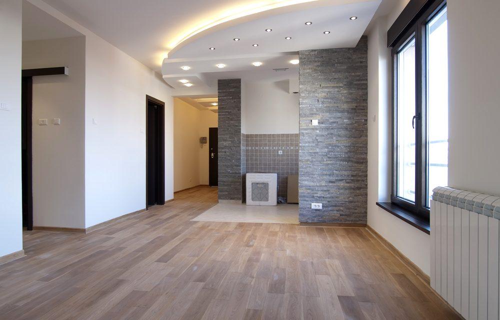 Plafond design spanplafond met led verlichting en spotlichten. Moderne woonkamer idee.